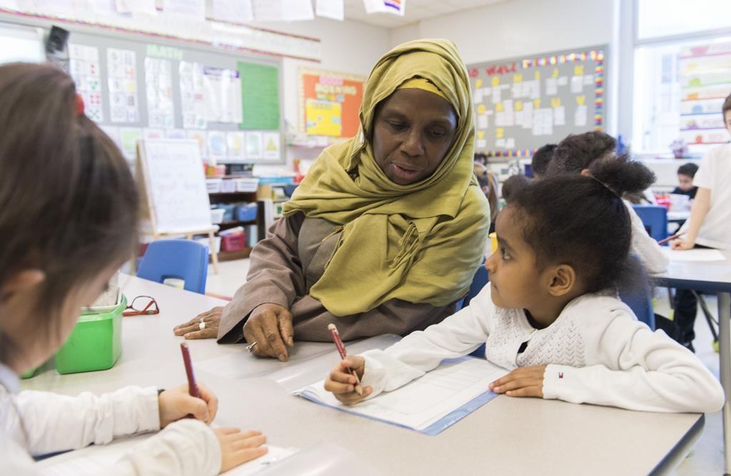 Kindergarten teacher Haniyfa Scott gives a lesson during class in Montreal, Thursday, April 4, 2019.