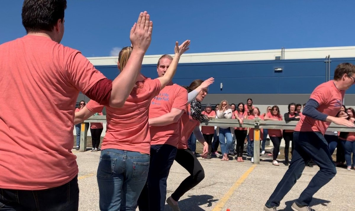 Staff at the Johnston Group set a new record on National High-Five Day.