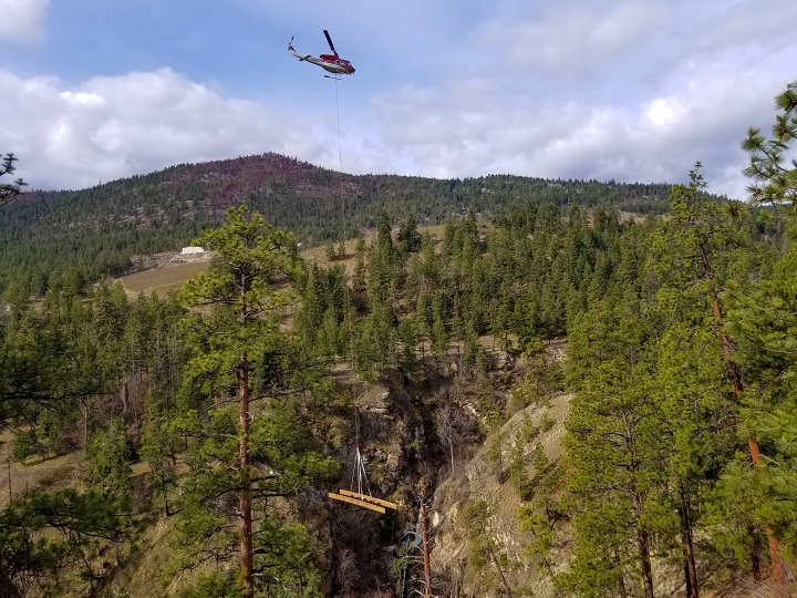 Two new bridges were flown into place on Thursday at Hardy Falls Regional Park in the Okanagan.