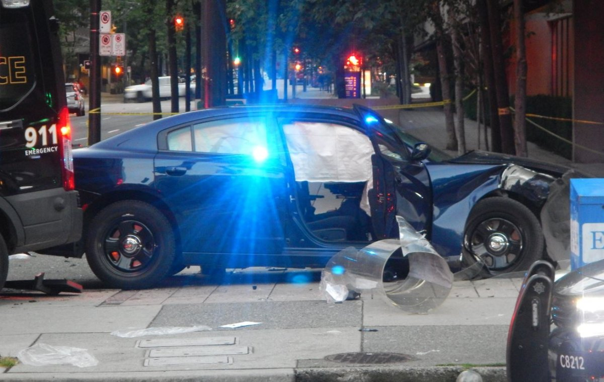 The scene of a collision between two VPD vehicles near the Vancouver Law Courts on June 30, 2018. The Independent Investigations Office is recommending charges against the officers involved, as well as the officer involved in another crash that same summer.