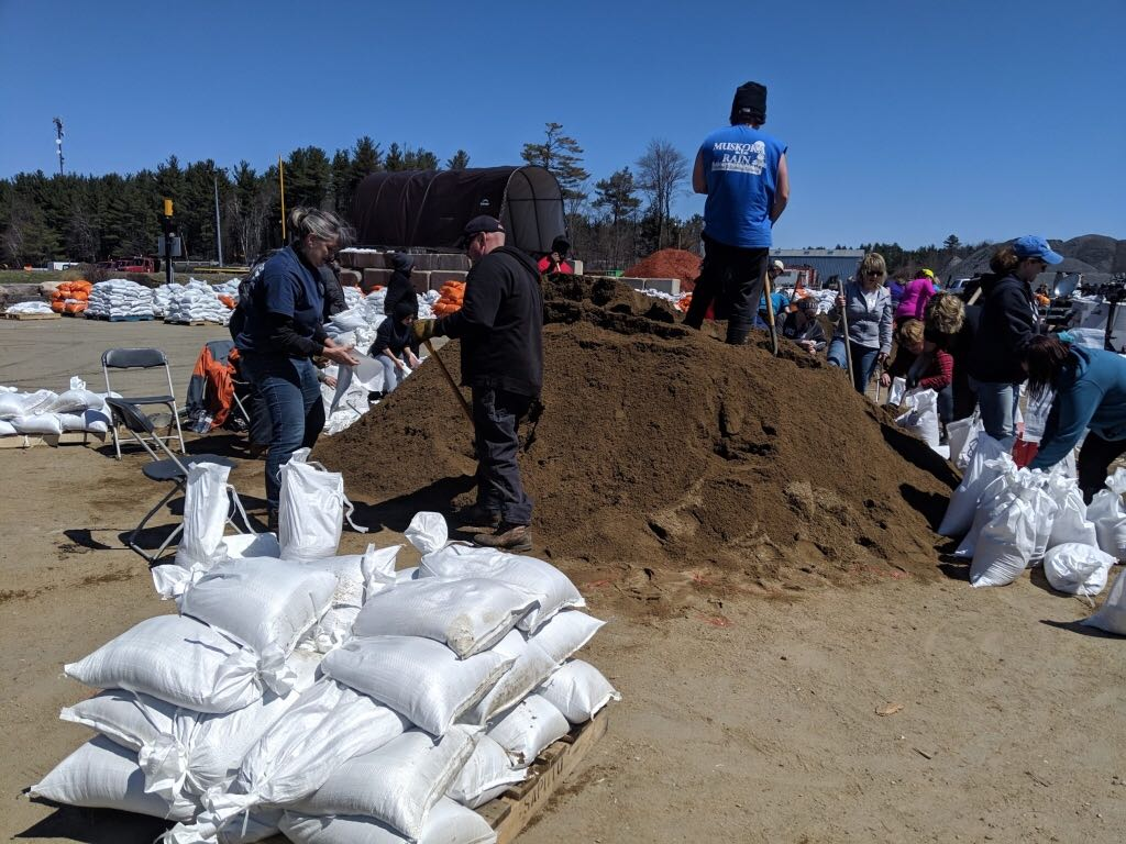 Sandbags and collected and filled in Bracebridge, Ont., amid flooding on Sunday, April 28.