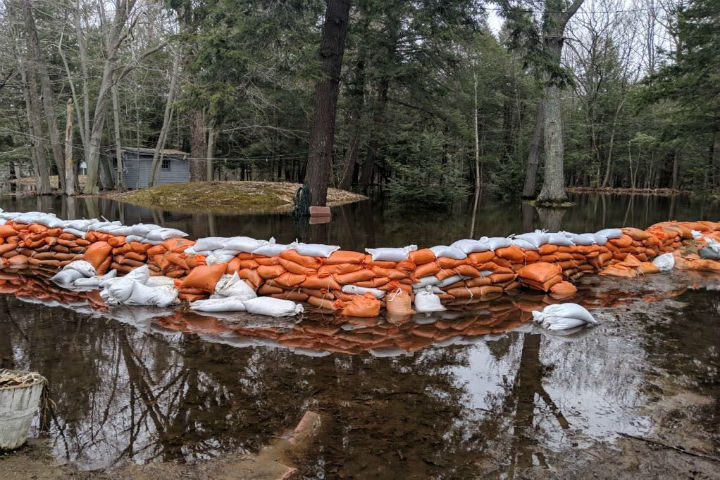 Sandbags efforts are shown in Bracebridge, Ont., April 29. The local health unit is now warning residents that used sandbags may be contaminated.