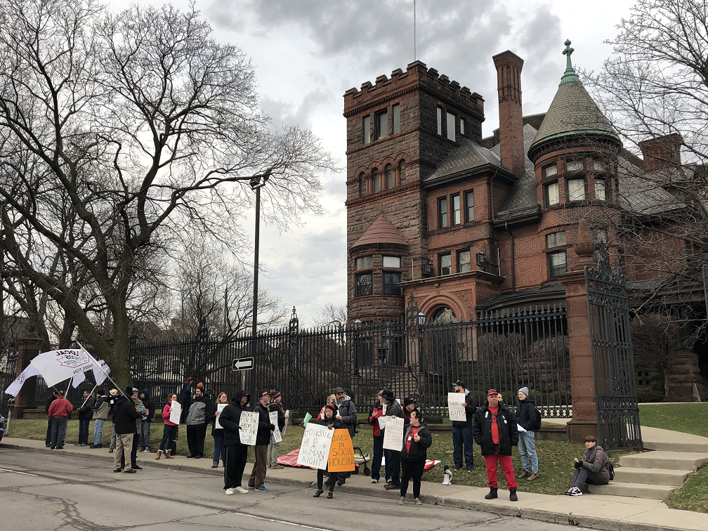 Protesters from ACORN and the Hamilton and District Labour Council rallied outside of the Scottish Rite on Friday morning.