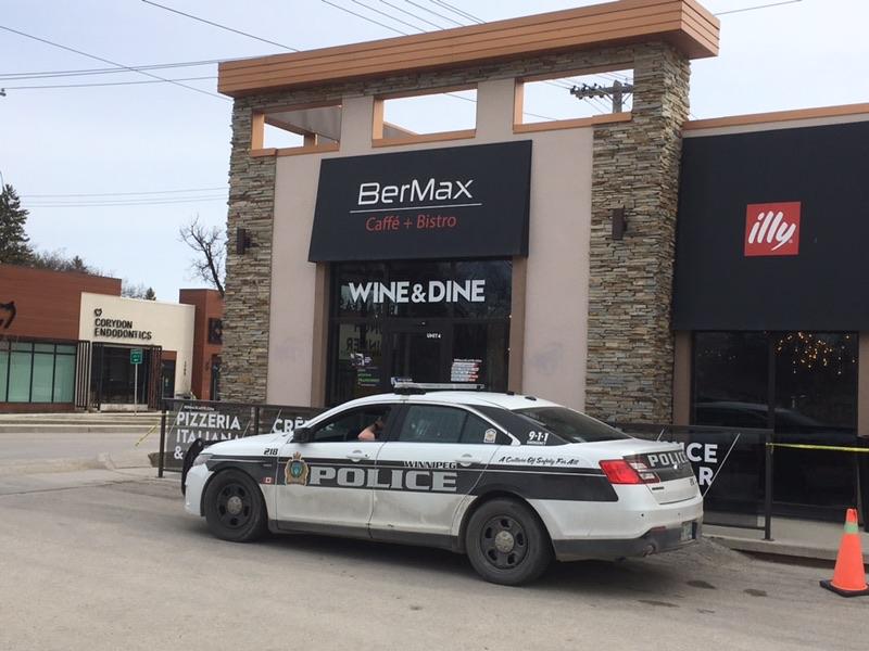 Winnipeg Police sit outside BerMax Caffe.