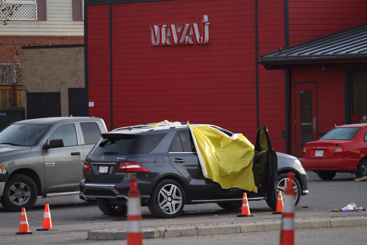 Calgary police investigate a deadly shooting in the parking lot outside Mazaj Lounge and Restaurant on Wednesday, April 3, 2019.