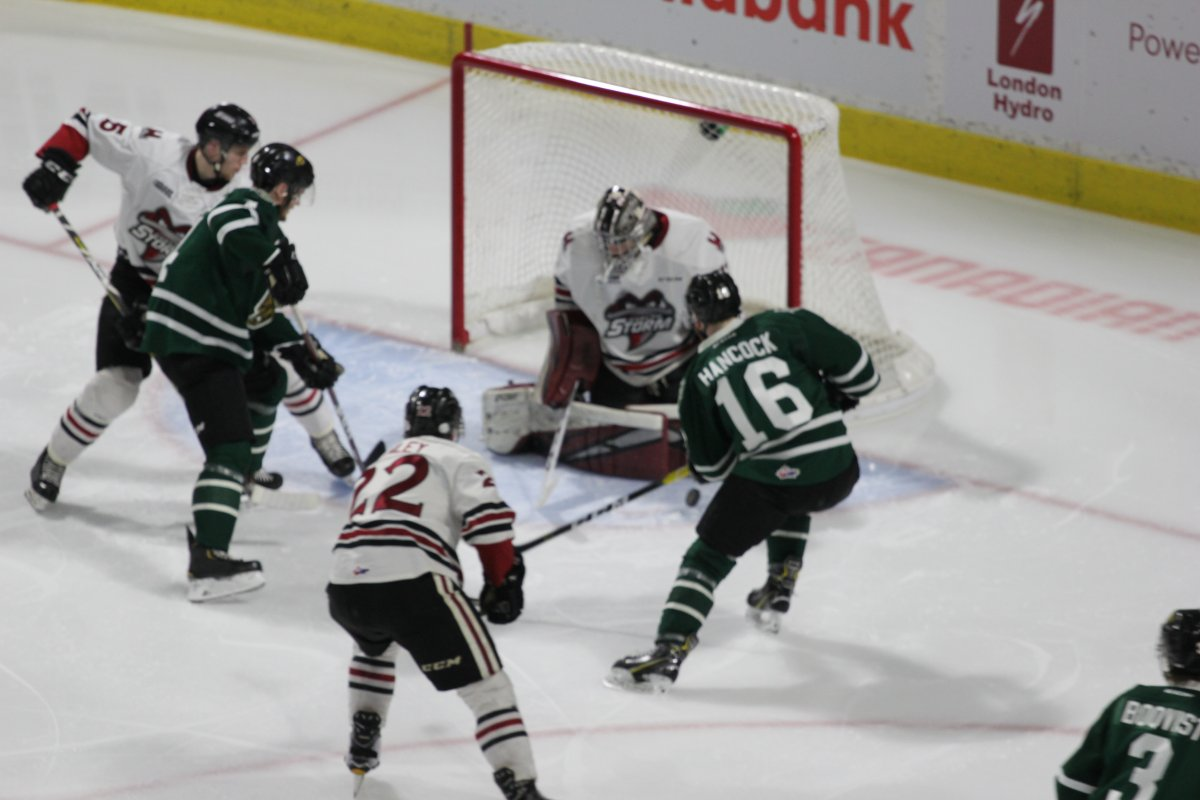 London, Ont - Anthony Popovich of the Guelph Storm makes a stop in close in a 3-1 Guelph Storm win over the London Knights in Game 5 of their best-of-7 second round series on April 12, 2019.