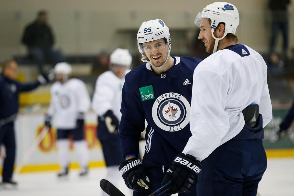 Winnipeg Jets' Mark Scheifele (55) and Kevin Hayes (12) joke around during practice prior to their first round of NHL playoff action against the St. Louis Blues in Winnipeg, Monday, April 8, 2019. THE CANADIAN PRESS/John Woods.