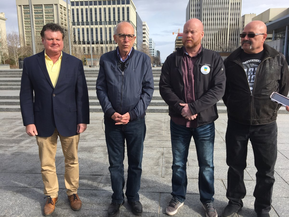 Stephen Mandel, second from the left, speaks about allegations of robocalls in the Alberta election on Sunday, April 14, 2019.