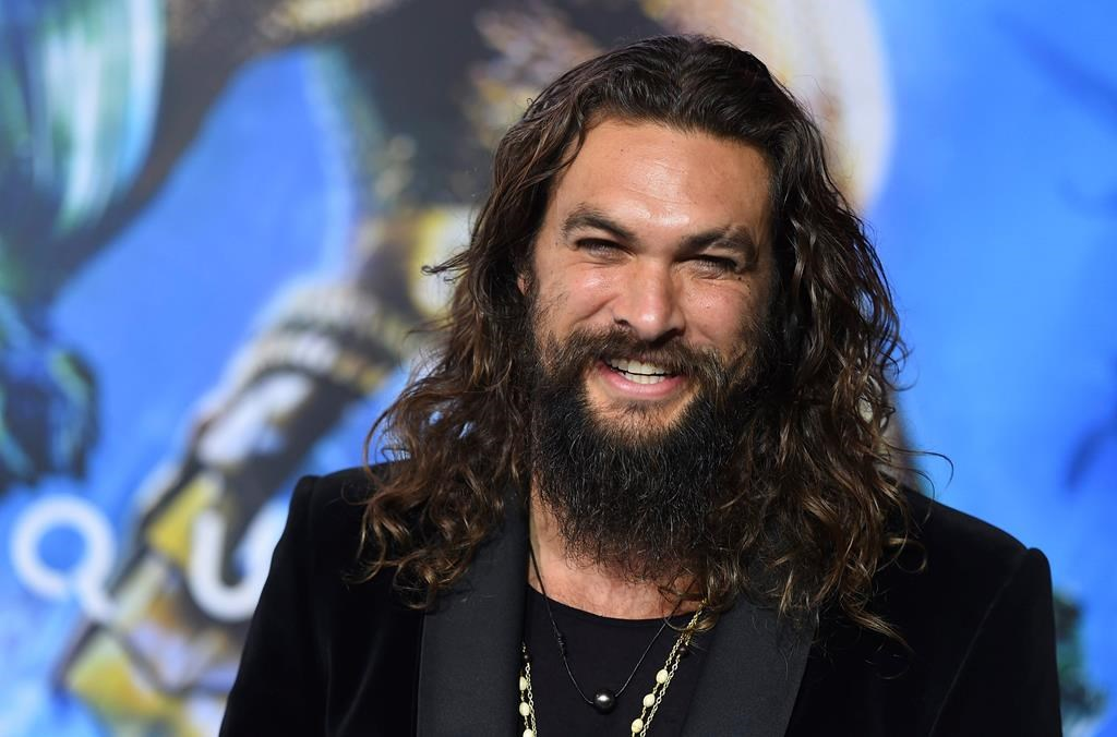 """In this Dec. 12, 2018 file photo, Jason Momoa arrives at the premiere of """"Aquaman"""" at TCL Chinese Theatre in Los Angeles."""