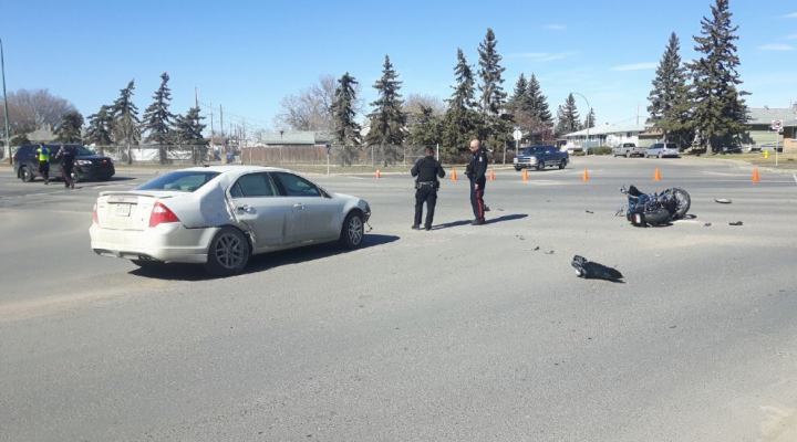 Regina Police are investigating a crash between a motorcycle and car that sent two people to hospital on Saturday.