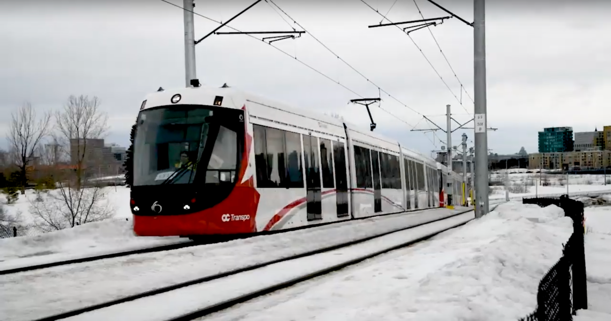A screen capture of a set of coupled LRT train cars being tested in the snow.
