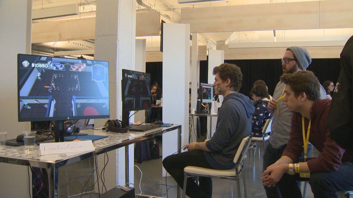 A university game developer tests out Escape Artist at the Ubisoft Game Lab Competition.