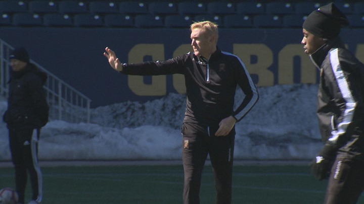 Valour FC general manager and head coach Rob Gale runs practice at Investors Group Field.