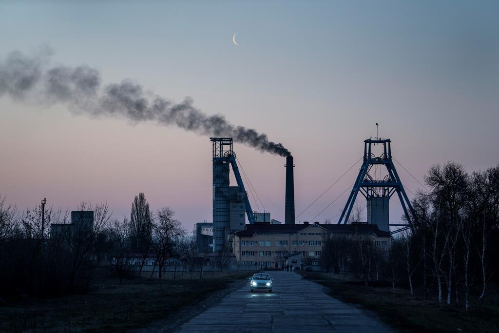 The Stepova coal mine just before dawn in Pershotravensk, Dnipropetrovsk region, eastern Ukraine, Monday, April 1, 2019.