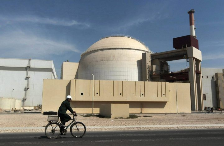 In this Oct. 26, 2010 file photo, a worker rides a bicycle in front of the reactor building of the Bushehr nuclear power plant, just outside the southern city of Bushehr.