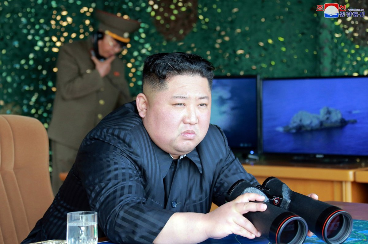 This Saturday, May 4, 2019, photo provided on Sunday, May 5, 2019, by the North Korean government shows North Korean leader Kim Jong Un, equipped with binoculars, observing tests of different weapons systems, in North Korea.