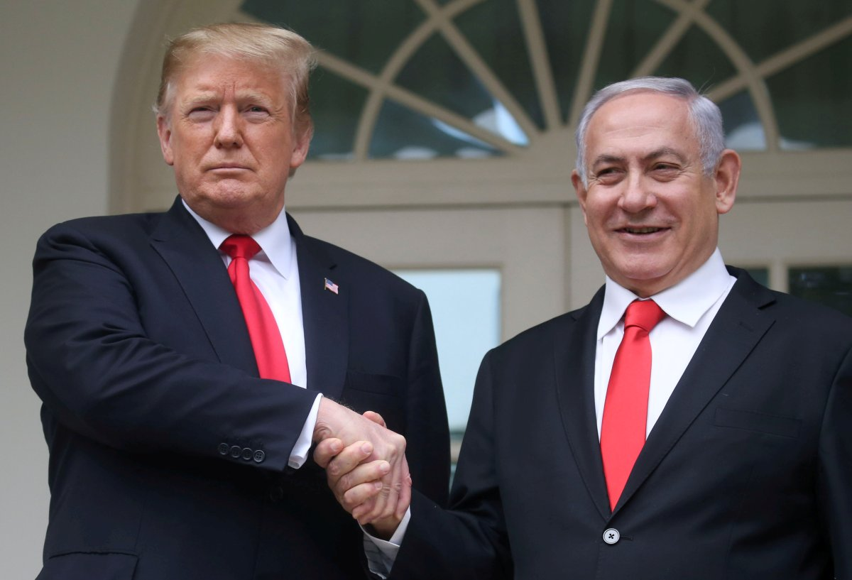 U.S. President Donald Trump shakes hands with Israel's Prime Minister Benjamin Netanyahu as they pose on the West Wing colonnade in the Rose Garden at the White House in Washington, U.S., March 25, 2019.