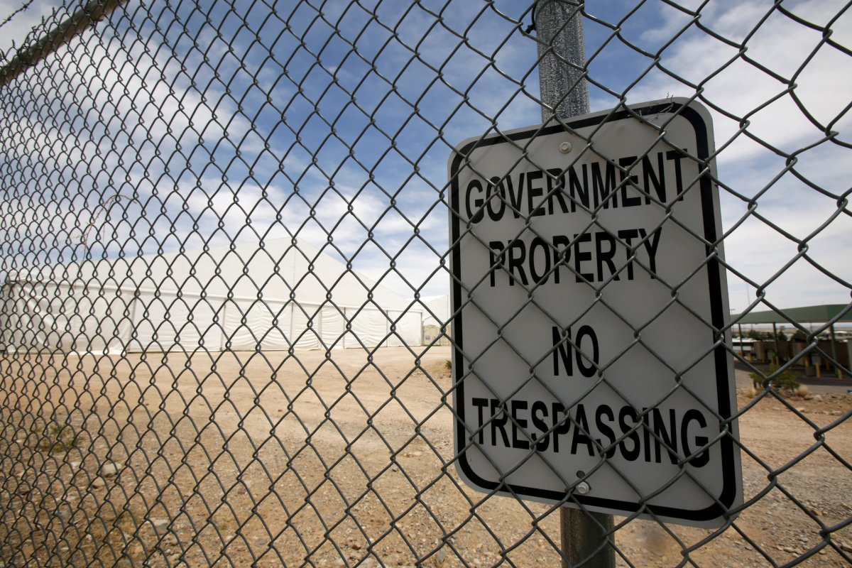 FILE PHOTO: A sign is pictured at a fence surrounding a temporary facility for processing migrants requesting asylum, at the U.S. Border Patrol headquarters in El Paso, Texas, U.S. April 29, 2019.