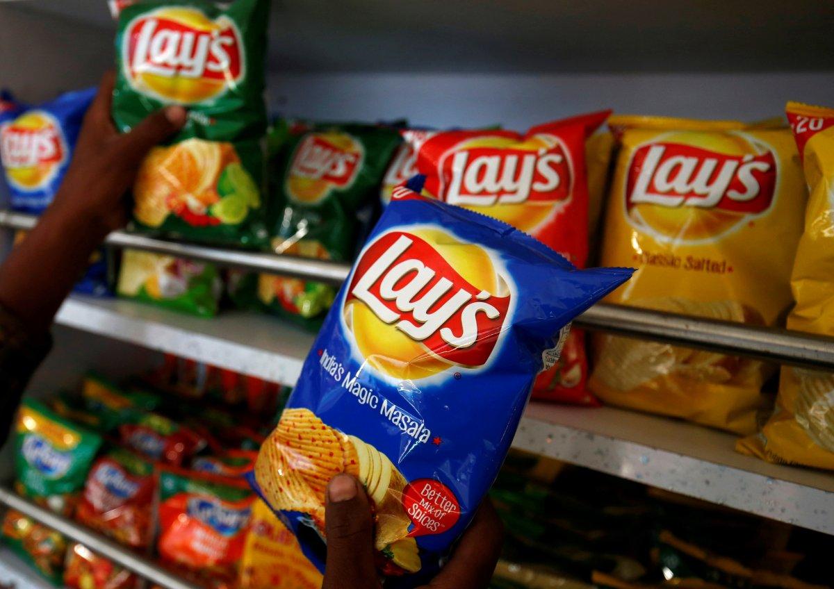 A customer picks packets of Lay's potato chips at a shop in Ahmedabad, India, April 26, 2019.