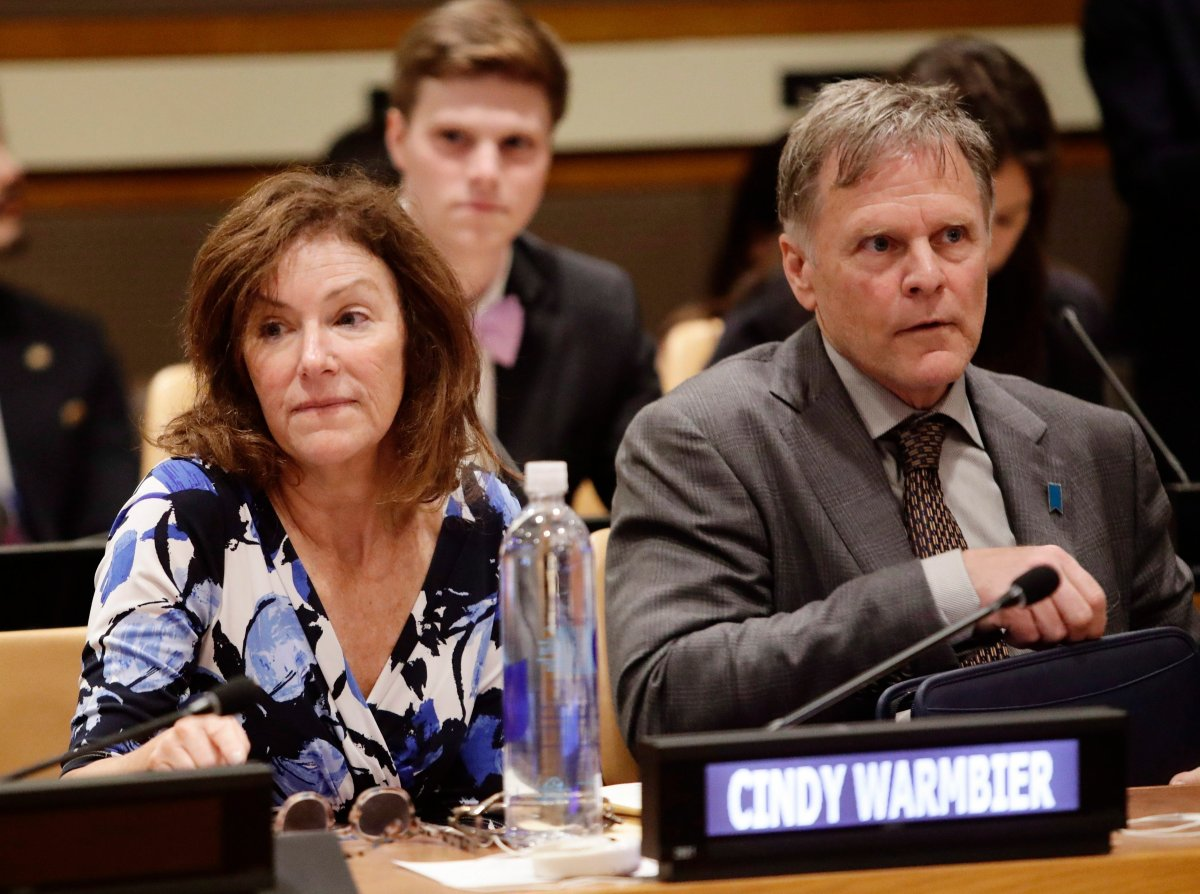 In this May 3, 2018, file photo, Fred Warmbier, right, and Cindy Warmbier, parents of Otto Warmbier, wait for a meeting at the United Nations headquarters.
