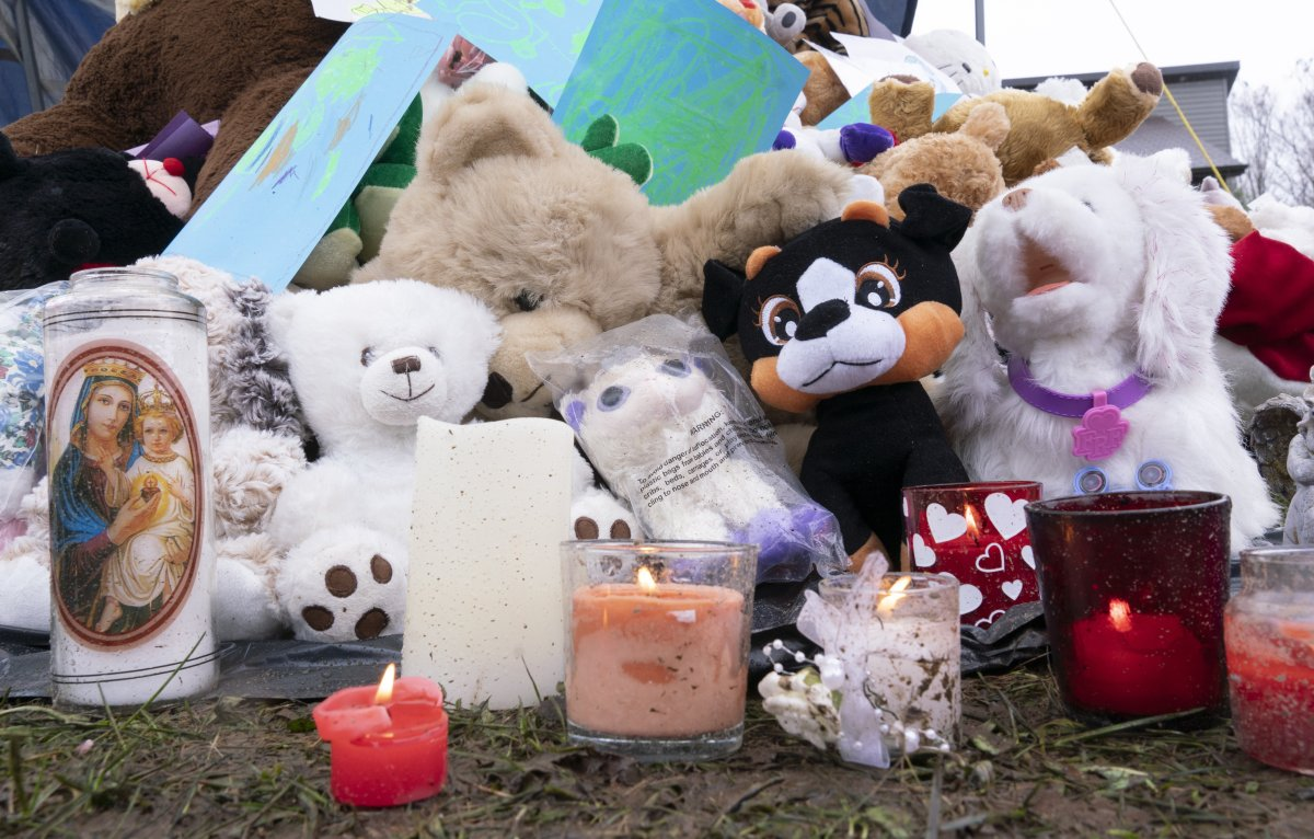 Stuffed animals are seen in front of the house where lived a 7-year-old girl who was found in critical condition in her home on Monday, April 29, in Granby, Que.