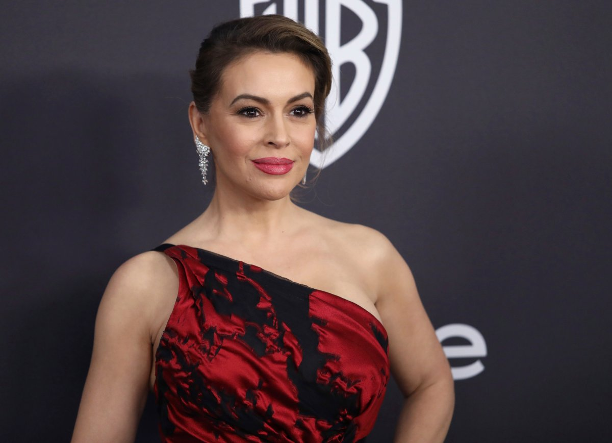 FILE - In this Jan. 6, 2019 file photo, Alyssa Milano arrives at the InStyle and Warner Bros. Golden Globes afterparty at the Beverly Hilton Hotel in Beverly Hills, Calif.