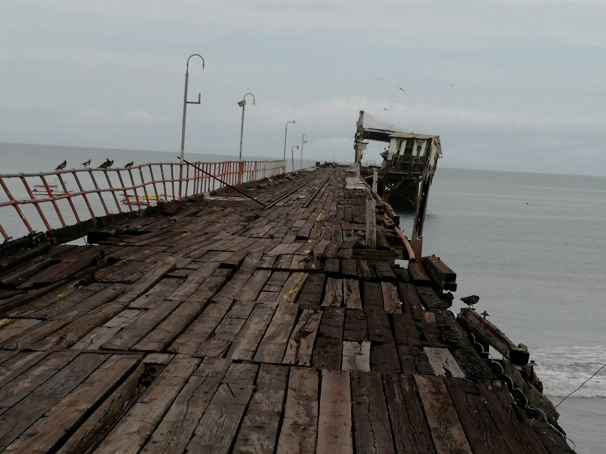 An office structure at the end of an abandoned pier, a local landmark, inclines to the right after an earthquake in Puerto Armuelles, Panama, Sunday, May 12, 2019.