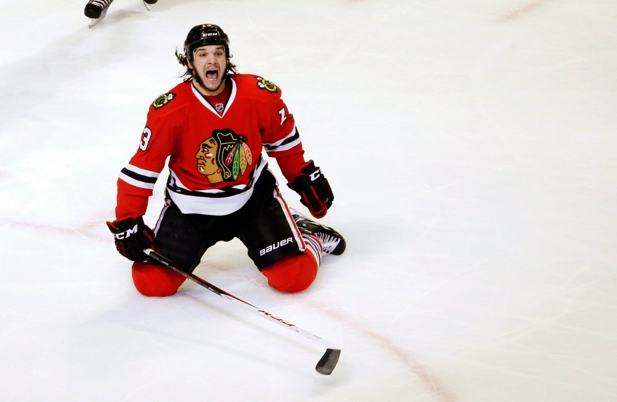 In this March 6, 2013, file photo, Chicago Blackhawks left wing Daniel Carcillo celebrates his winning goal during the third period of an NHL hockey game against the Colorado Avalanche, in Chicago.
