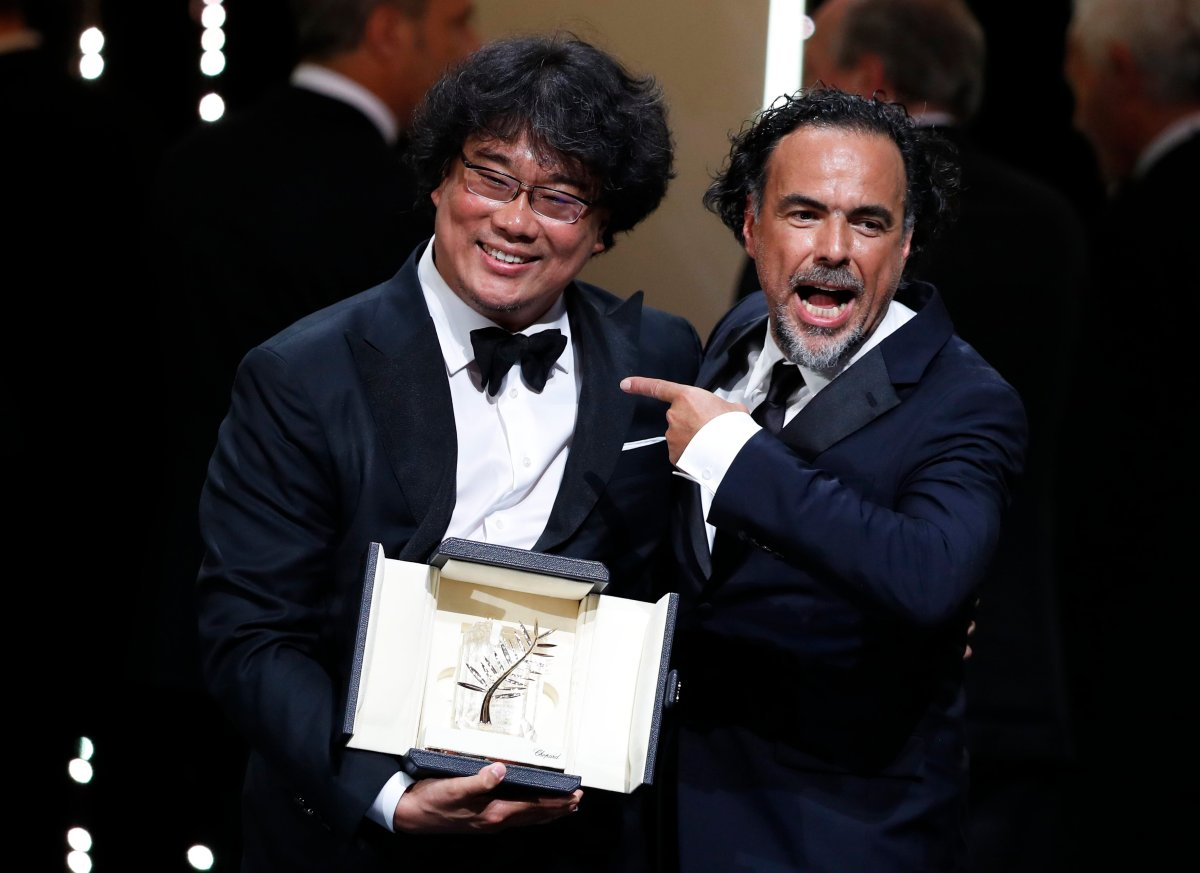 South Korean director Bong Joon-ho (L) with his Palme d'Or (Golden Palm) for the movie 'Parasite' with President of the Jury, Mexican director Alejandro Gonzalez Inarritu (R) during the Closing Awards Ceremony of the 72nd Cannes Film Festival, in Cannes, France, 25 May 2019.