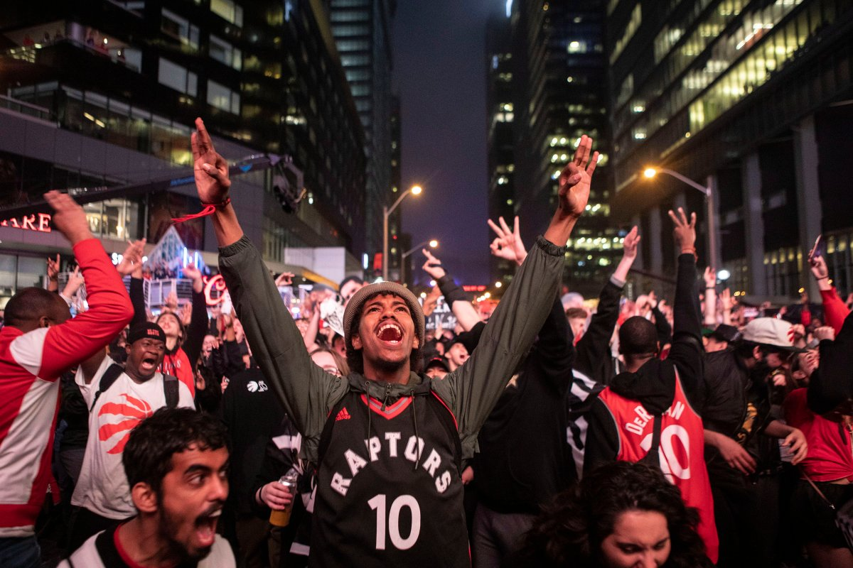 Toronto Raptors fans react as they watch game six of NBA Eastern Conference Final basketball action between the Toronto Raptors and Milwaukee Bucks on a screen outside the Scotiabank Arena, in Toronto on Saturday, May 25, 2019.