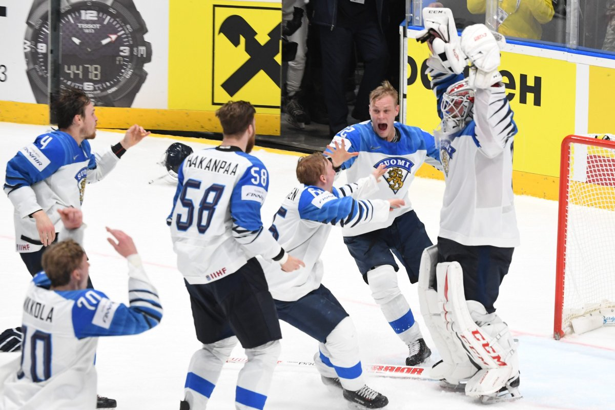 Team Finland and goalkeeper Kevin Lankinen celebrate after beating Canada 3-1 in the 2019 IIHF Ice Hockey World Championships final match between Canada and Finland in Bratislava, Slovakia, on May 26, 2019.