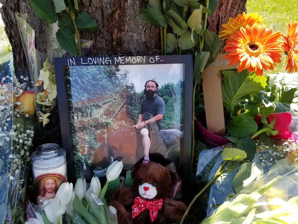 A memorial for Adam Umbelina is seen Wednesday at the scene of the May 7, 2019 collision that claimed his life on Clarke Road near Dundas Street.