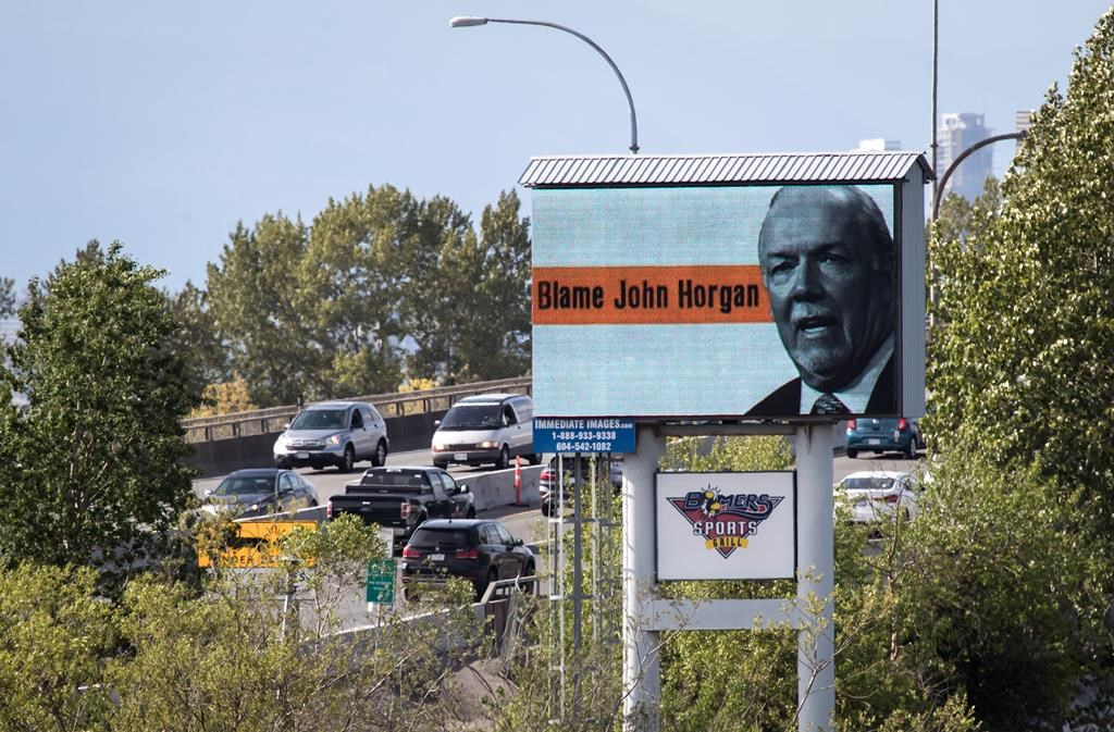 Motorists travel over the Alex Fraser Bridge as an electronic billboard paid for by the B.C. Liberal caucus, placing blame for high gas prices on Premier John Horgan is seen in Delta, B.C., on Saturday May 4, 2019.