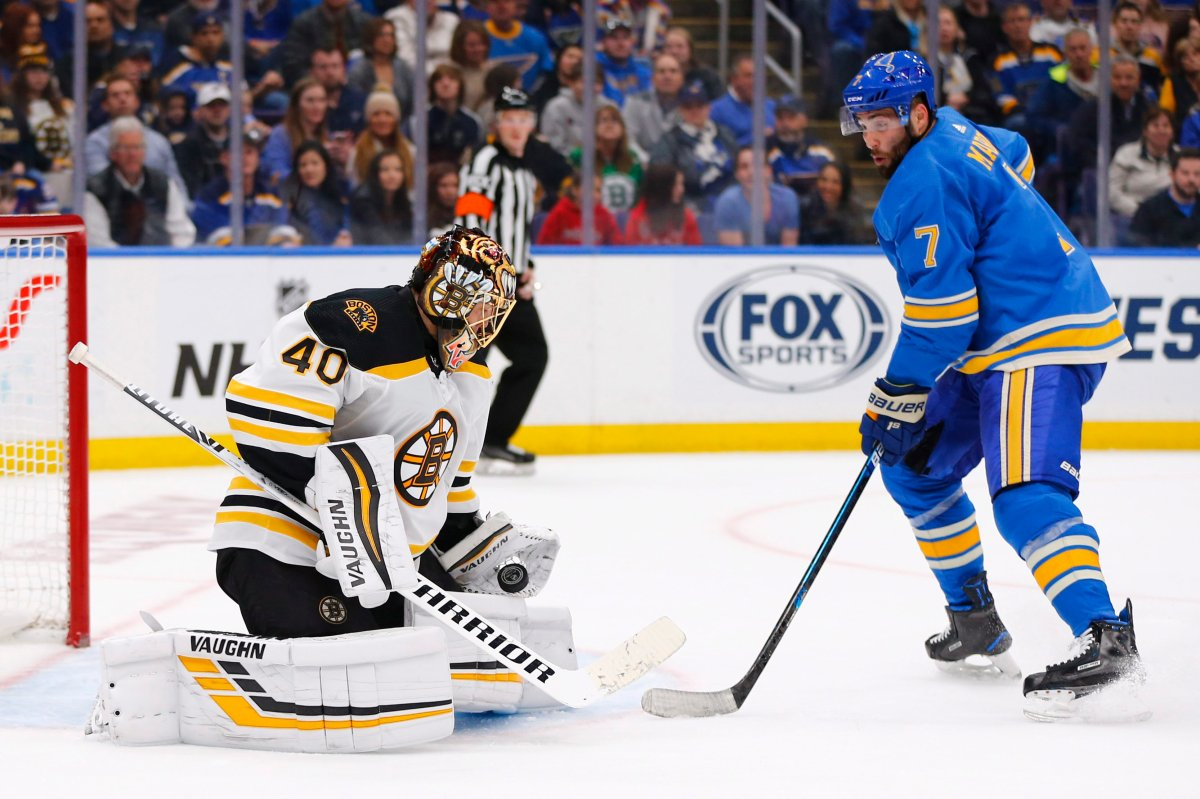 Boston Bruins goalie Tuukka Rask, left, makes a save against St. Louis Blues' Patrick Maroon during a game on Feb. 23, 2019, in St. Louis.