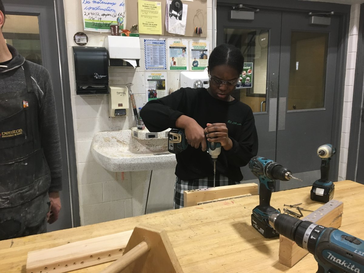 A student participates in the home maintenance workshop, as part of adulting courses at E.J. Lajeunesse catholic high school.