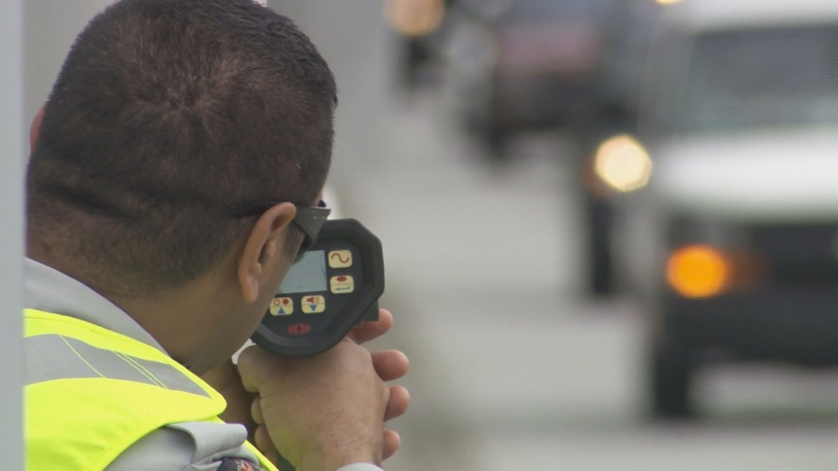 An RCMP officer aims a radar gun in this undated file photo.