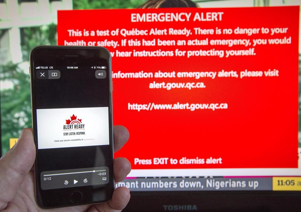 Public Safety Canada says it received notification last week from Ontario and Quebec that the provinces are opting out of the testing because neither wants to send unnecessary alert tones to residents dealing with historic flooding. A smartphone and a television receive visual and audio alerts to test Alert Ready, a national public alert system in Montreal, Monday, May 7, 2018.