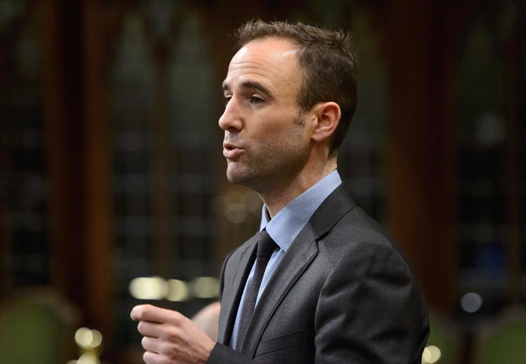 Liberal MP Matt DeCourcey, the parliamentary secretary to the minister of Immigration, stands during question period in the House of Commons on Parliament Hill in Ottawa on Friday, Dec. 7, 2018.