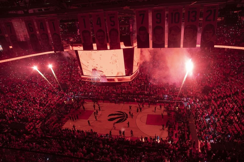 Pyrotechnics illuminate the court before first half NBA Eastern Conference finals action between the Toronto Raptors and the Milwaukee Bucks, in Toronto on Saturday, May 25, 2019.