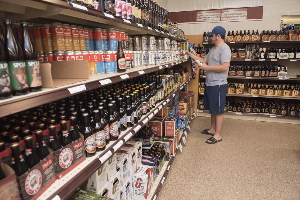 A customer shops in the craft beer section of the NB Liquor store in Fredericton, N.B., on Friday, June 16, 2017.