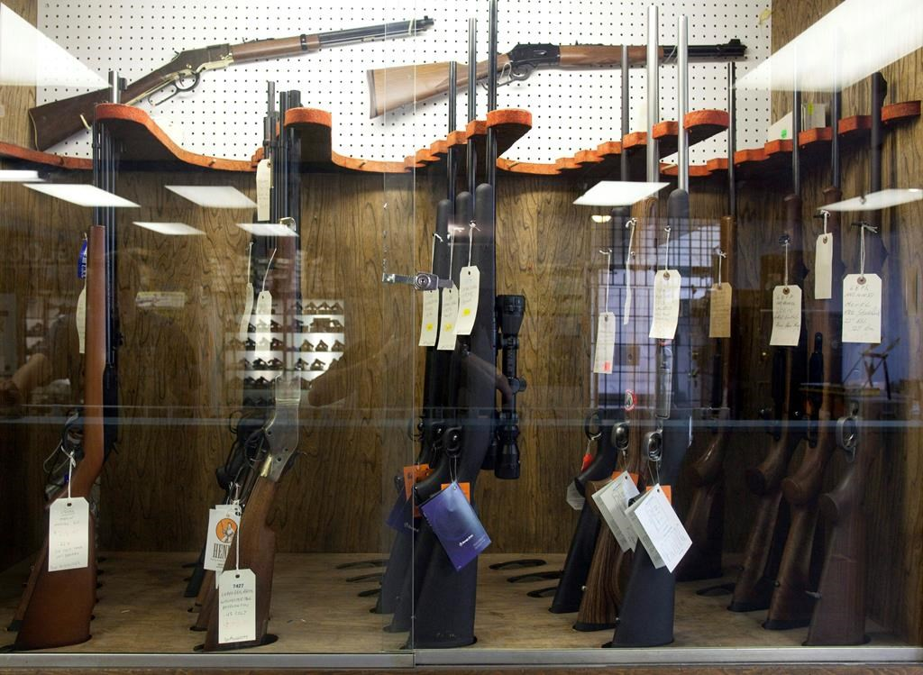 Hunting rifles are seen on display in a glass case at a gun and rifle store in downtown Vancouver, Wednesday, Sept. 15, 2010. The Senate has passed a Liberal government bill that would expand the scope of background checks on those who want to acquire a gun. THE CANADIAN PRESS/Jonathan Hayward.