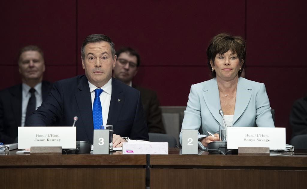 Alberta Premier Jason Kenney and Minister of Energy for Alberta Sonya Savage, right, prepare to appear at the Standing Senate Committee on Energy, the Environment and Natural Resources about Bill C-69 at the Senate of Canada Building on Parliament Hill in Ottawa on May 2, 2019.