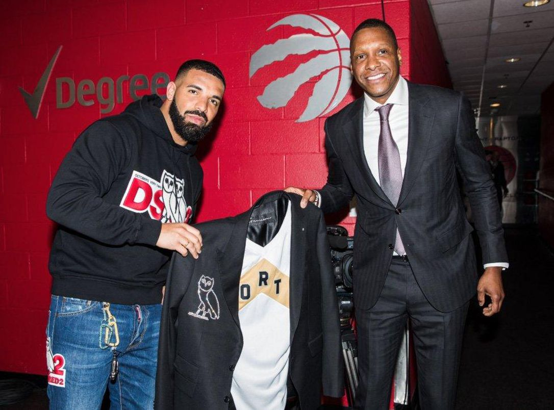 Raptors president Masai Ujiri gives Drake a diamond-crusted jacket on Tuesday night before Game Four between the Raptors and the Bucks.