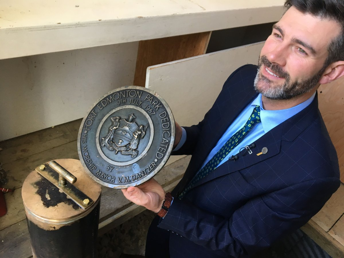 Mayor Don Iveson displaying the cover of the time 1967 centennial capsule buried Fort Edmonton Park on Wednesday, May 22, 2019.