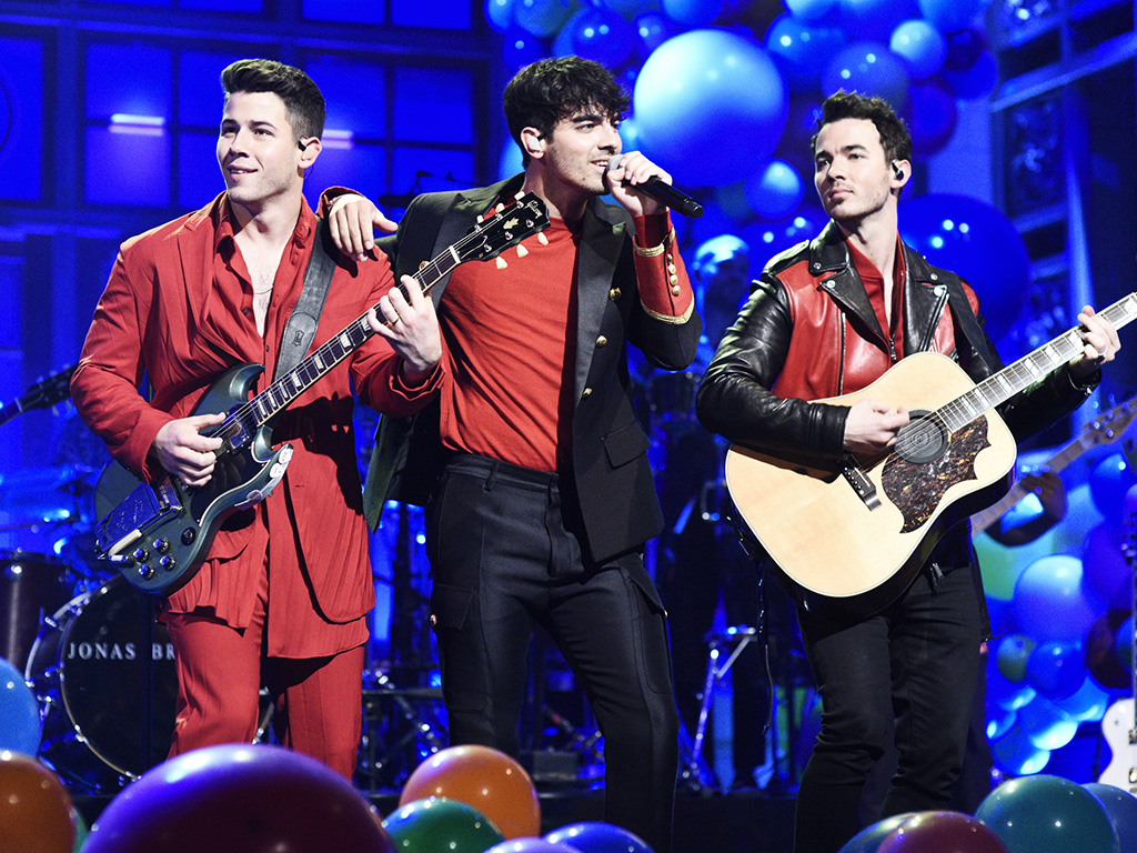 """SATURDAY NIGHT LIVE -- """"Emma Thompson"""" Episode 1766 -- Pictured: Musical guest Jonas Brothers perform on Saturday, May 11, 2019 -- (Photo by: Will Heath/NBC/NBCU Photo Bank via Getty Images)."""