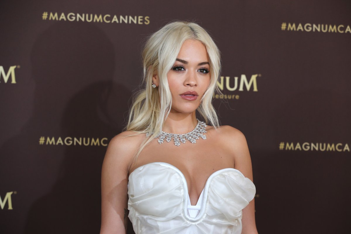 """Rita Ora wearing jewelry by Chopard during the photocall for """"MAGNUM x Rita_Ora"""" during the 72nd annual Cannes Film Festival on May 16, 2019 in Cannes, France."""