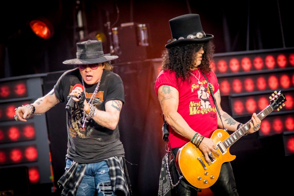 OTTAWA, ON - AUGUST 21:  Axl Rose and Slash of Guns N' Roses perform onstage during the 'Not In This Lifetime' Tour  at TD Place Stadium on August 21, 2017 in Ottawa, Canada.  (Photo by Mark Horton/Getty Images).