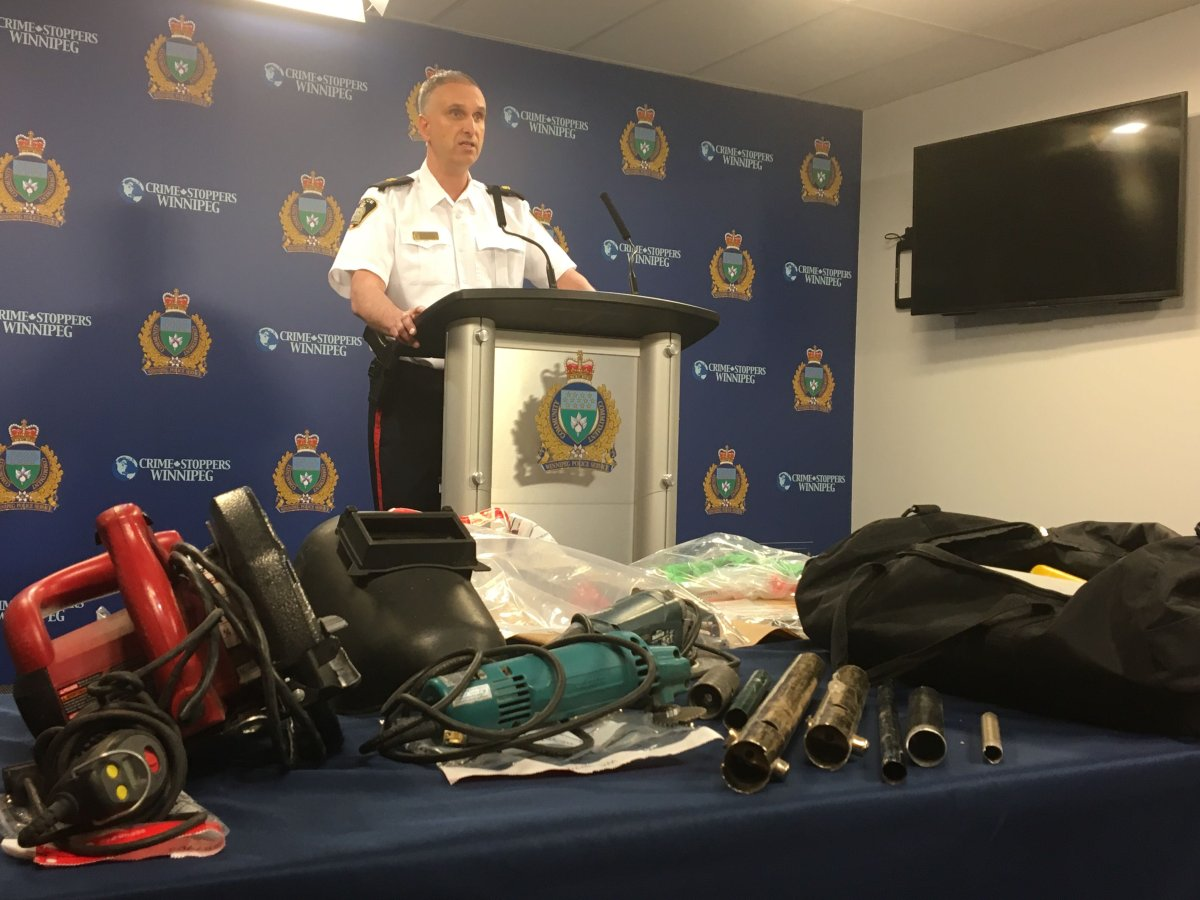 Insp. Max Waddell with a table full of zip guns taken off of Winnipeg streets.