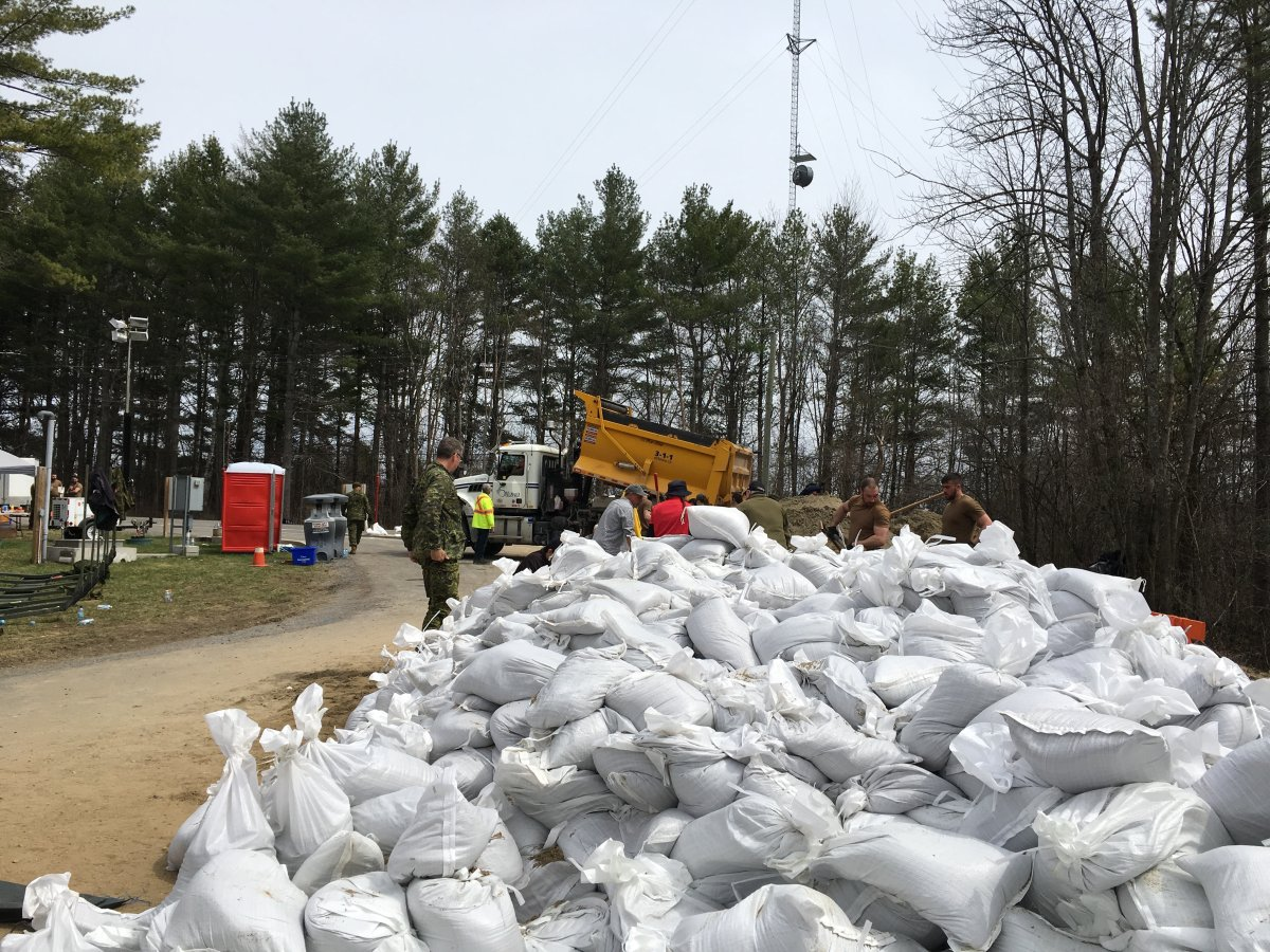 As the Ottawa River spills over into Constance Bay and Fitzroy Harbour, volunteers and Canadian military members fill sandbags at Fitzroy Provincial Park on Monday, April 29, 2019.