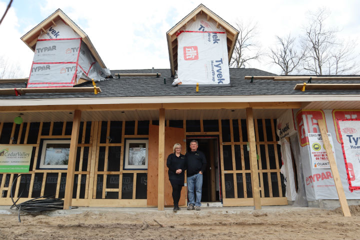 Koko and Robert Saar stand in front of their Wasaga Beach passive house, which is expected to complete construction in the summer.